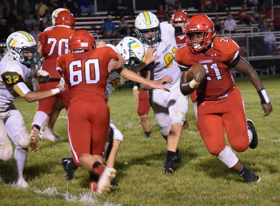 Jacksonville's Chris Pulley advances toward the goal line Friday night in a game against University High. Pulley finished with 150 rushing yards. More photos at myjournalcourier.com Photo: Audrey Clayton | Journal-Courier