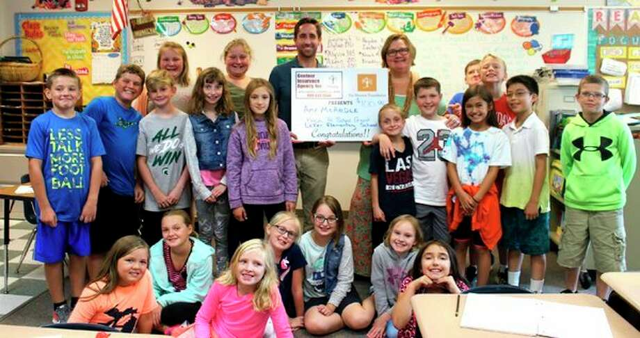 Laker fourth grade teacher Amy McArdle recently received a $100 Back to School grant from the Gentner Insurance Agency and the Meemic Foundation. Dan Gentner visited McArdle's classroom to present the award. McArdle plans to use the funds to purchase books for her classroom. (Submitted Photo)