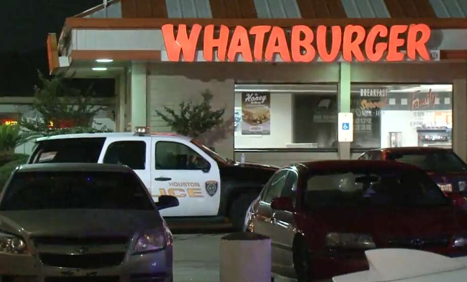 An apparent would-be robber began shooting about 1 a.m. Saturday inside a Whataburger restaurant on West Bellfort at Braes Ridge. A security guard returned fire, hitting the suspect, who collapsed and died next to his car, Houston police say. Photo: Metro Video