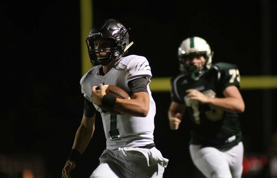Legacy Prep senior quarterback Jack Granack, left, runs for the end zone ahead of The Woodlands Christian Academy junior defender Jason Ellis (73) in the 3rd quarter of their matchup at TWCA on Friday, Sept. 14, 2018. Photo: Jerry Baker, Houston Chronicle / Contributor / Houston Chronicle