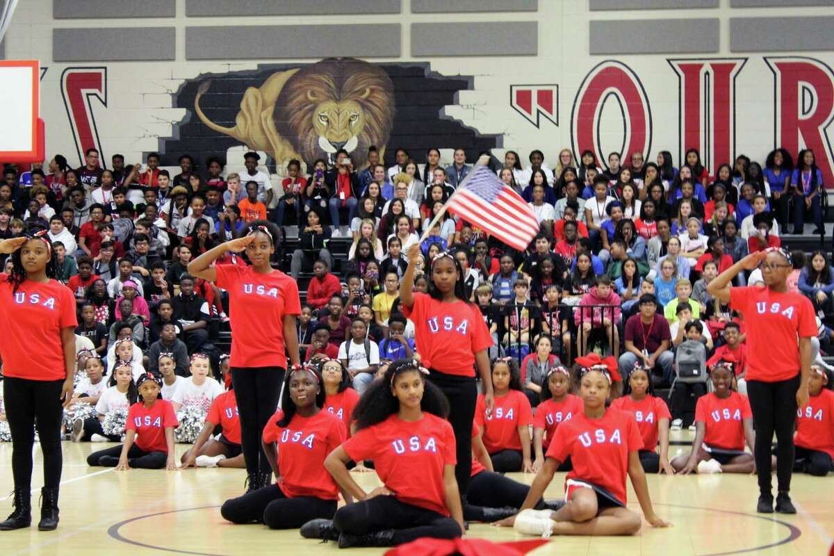 The Woodcreek Middle School step team performs during the Sept. 14 pep rally.