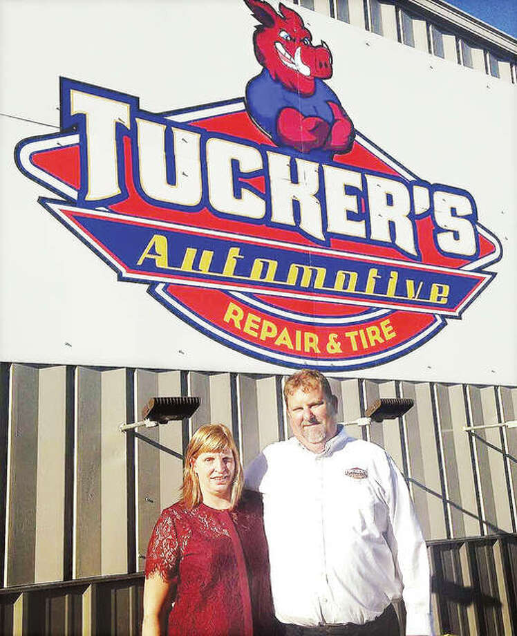 Chuck Tucker, with his wife Beth, outside the service facility at Tucker's Automotive Repair and Tire that opens Monday in Godfrey. Photo: Linda N. Weller | The Telegraph