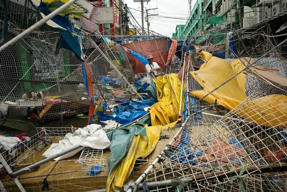People clear the wreckage and debris of street stalls at a bazaar after Typhoon Mangkhut in Tuguegarao, Cagayan province, the Philippines, on Saturday, Sept. 15, 2018. Super Typhoon Mangkhut battered the Philippines with gales and torrential rains, leaving at least three people dead and thousands homeless, triggering landslides and damaging an airport before heading toward China. Photographer: Carlo Gabuco/Bloomberg Photo: Carlo Gabuco / Bloomberg