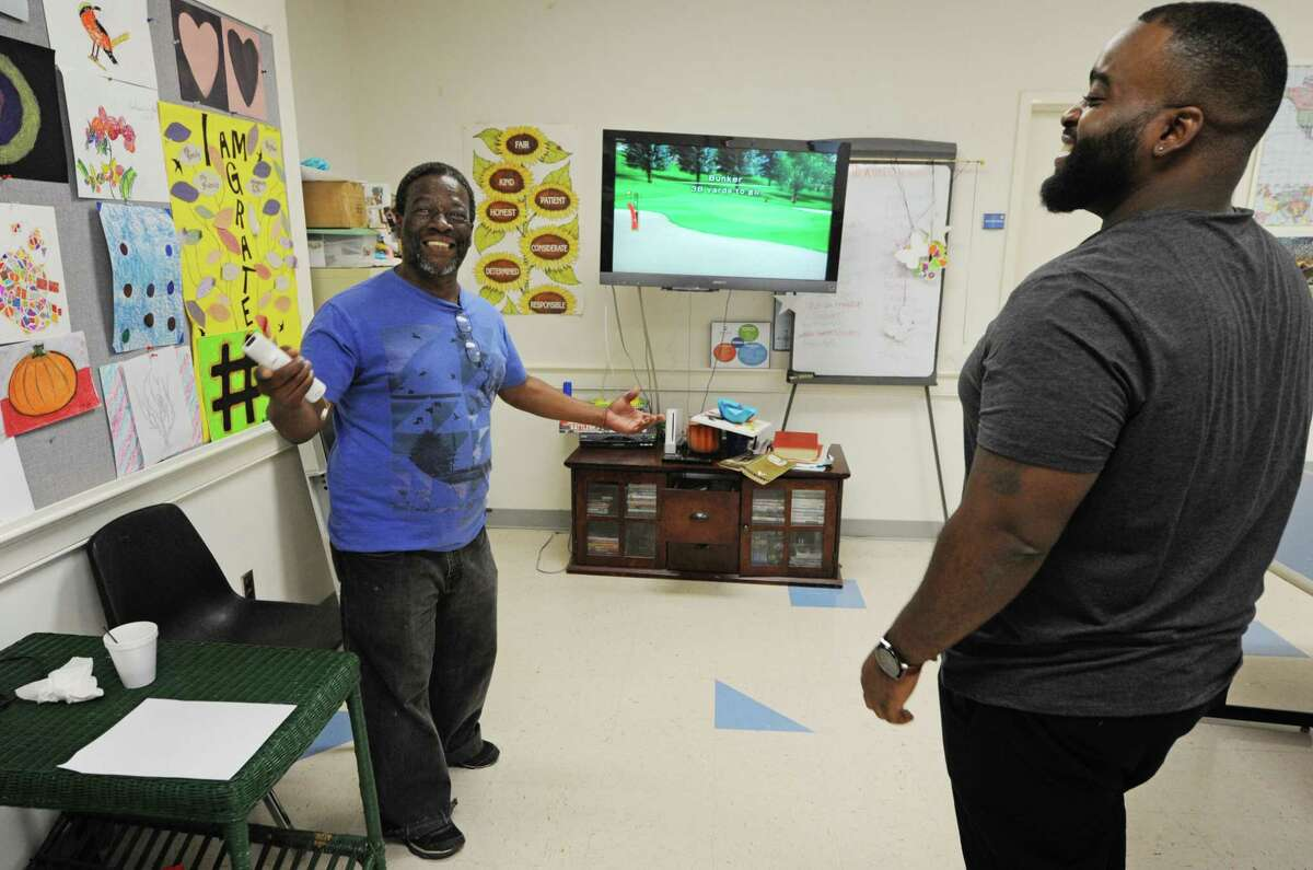 Keystone House client Jerome Barr plays Wii Golf with staffer Jeffry Smith Thursday, September 6, 2018, at Keystone's Community Living Center on Main Avenue in Norwalk, Conn.
