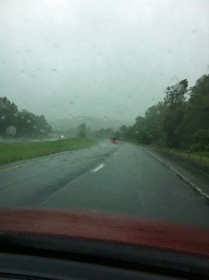 Driving along I-84 to work as the front edge of Tropical Storm Irene begins to reach Connecticut on Sunday, Aug. 28, 2011. Photo: Jacqueline Smith / Hearst Connecticut Media
