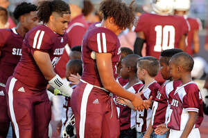 Silsbee Varsity players greet the youth during the pregame as Silsbee hosts Nederland in a non-district game on 9/14/2018. Friday, September 14, 2018 Drew Loker/special toThe Enterprise
