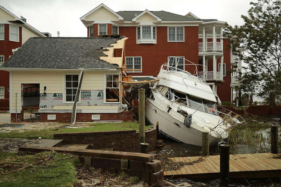 High winds on the Neuse River in New Bern, N.C., smashed a boat against a garage. The storm buckled buildings, deluged towns and knocked out power to more than 900,000 customers. Photo: Chip Somodevilla / Getty Images