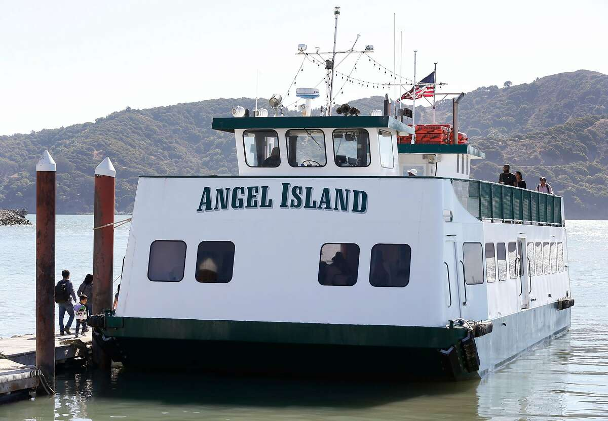 Passengers board a ferry boat captained by Maggie McDonogh for a short trip to Angel Island from Tiburon, Calif. on Saturday, Sept. 15, 2018. McDonogh's Tiburon Angel Island Ferry Company is battling the California State Parks over concession fees and dock maintenance on Angel Island.