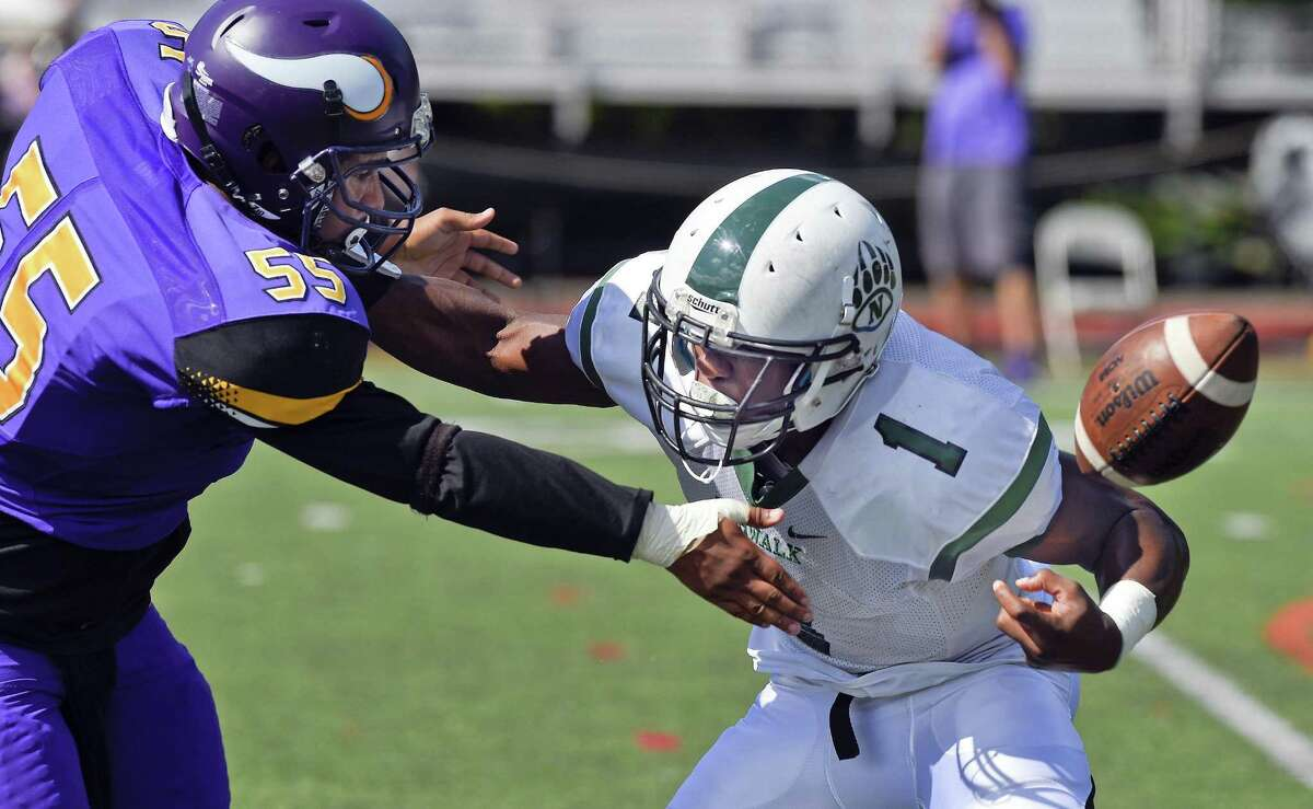 Norwalk runningback Jakari Walker (1) loses the ball under pressure from Westhill Sakoi Cheatham (55) in a FCIAC football game on Saturday, Sept. 15, 2018 in Stamford, Connecticut. Norwalk defeated Westhill 48-21 in the Vikings home opener at J.Walter Kennedy Stadium.