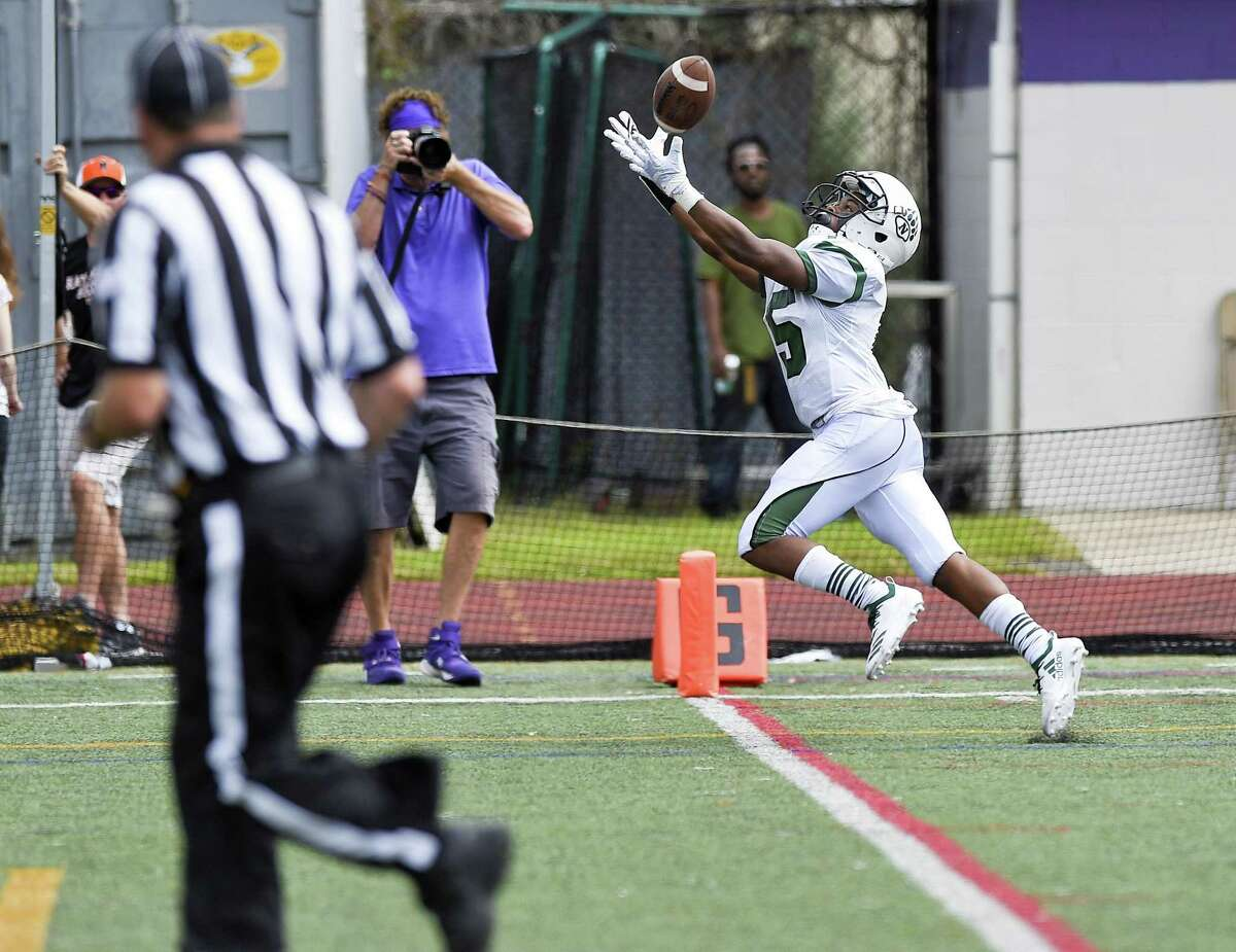 Norwalk Khalil Eason (15) makes a touchdown reception against Westhill in a FCIAC football game on Saturday, Sept. 15, 2018 in Stamford, Connecticut. Norwalk defeated Westhill 48-21 in the Vikings home opener at J.Walter Kennedy Stadium.