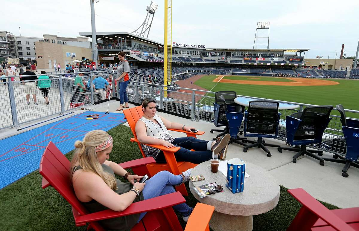 Alli Quist (left) and Chelsee Chapin relax at The Band Box in the right field area of First Tennessee Park before the Nashville Sounds and Round Rock Express baseball game Friday June 3, 2016 in Nashville, Tennessee.
