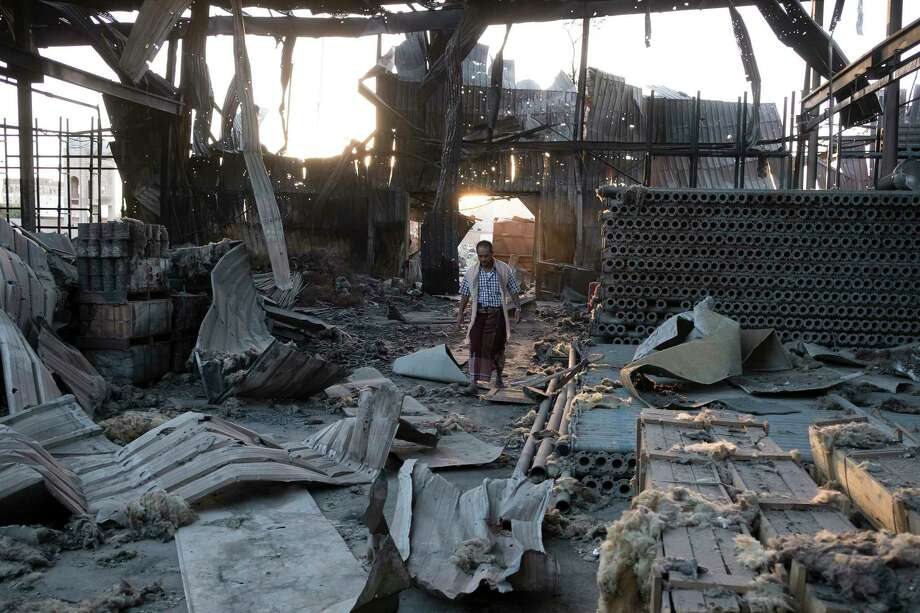 FILE — The aftermath of a bombing that destroyed three factories in Sanaa, Yemen, Oct. 29, 2016. The Saudi-led coalition of Arab countries has bombed Yemen for more than two years in a war to rout Yemen's Houthi rebels, and now the United Nations has placed Saudi Arabia on a draft blacklist of countries that kill and maim children in war. (Tyler Hicks/The New York Times) ORG XMIT: XNYT245 Photo: TYLER HICKS / NYTNS