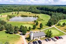 Buy a condo in the city or a whole golf course somewhere else in the nation. You'll spend less on the latter. This $50K course is in Grand Haven, WI.
