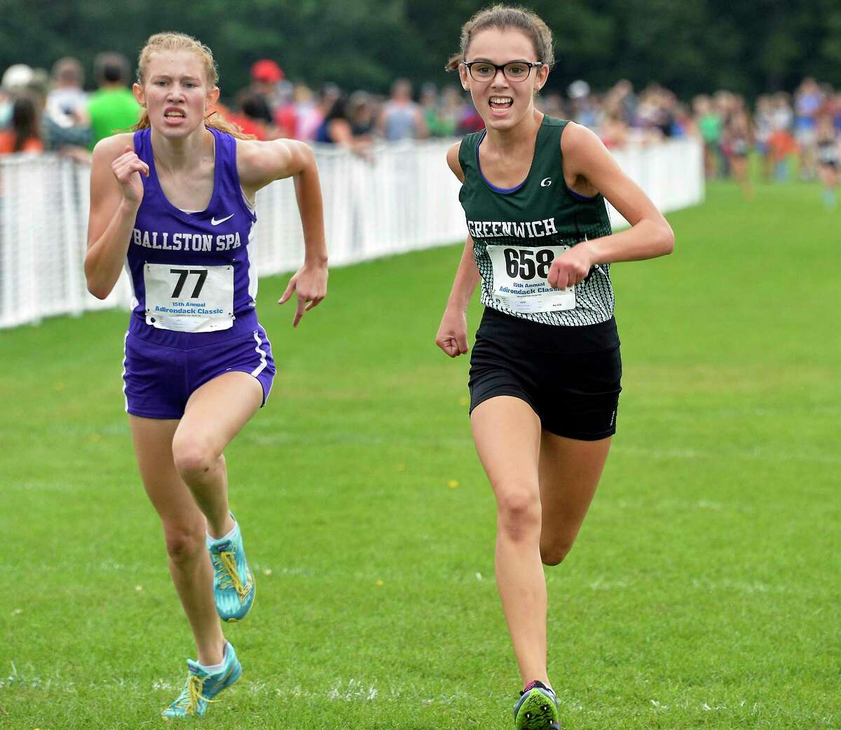 Ballston Spa's Faith DeMars, left, finishes third to Greenwich's Nina Sgambellura second place in the Division I girls race during the 15th annual Adirondack Classic Invitational Saturday Sept. 15, 2018 in Queensbury, NY. (John Carl D'Annibale/Times Union)