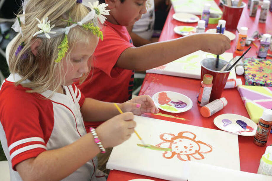 A youngster paints a flower at a previous Edwardsville Art Fair. Photo: Intelligencer Photo