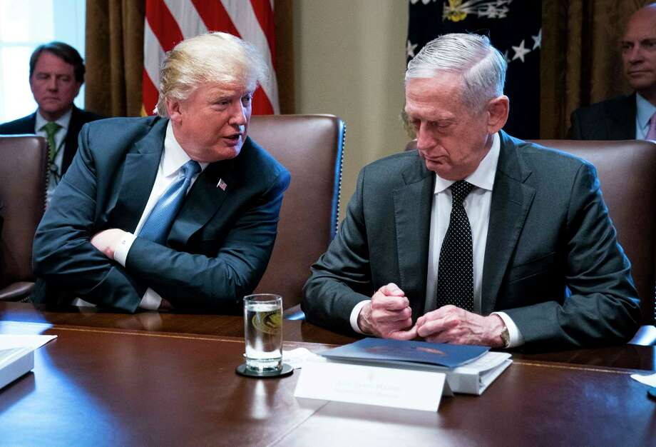 FILE -- President Donald Trump speaks to Defense Secretary Jim Mattis during a Cabinet meeting at the White House in Washington, June 21, 2018. Officials say that the president has soured on his defense secretary, and that Mattis is increasingly weary of capricious demands from his boss. (Doug Mills/The New York Times) Photo: DOUG MILLS / NYTNS
