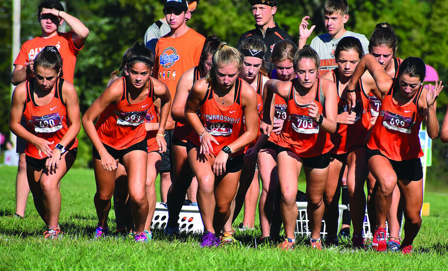 The Edwardsville girls' cross country team begins the Edwardsville Invitational race on Saturday morning on the campus of SIUE. Photo: Matthew Kamp
