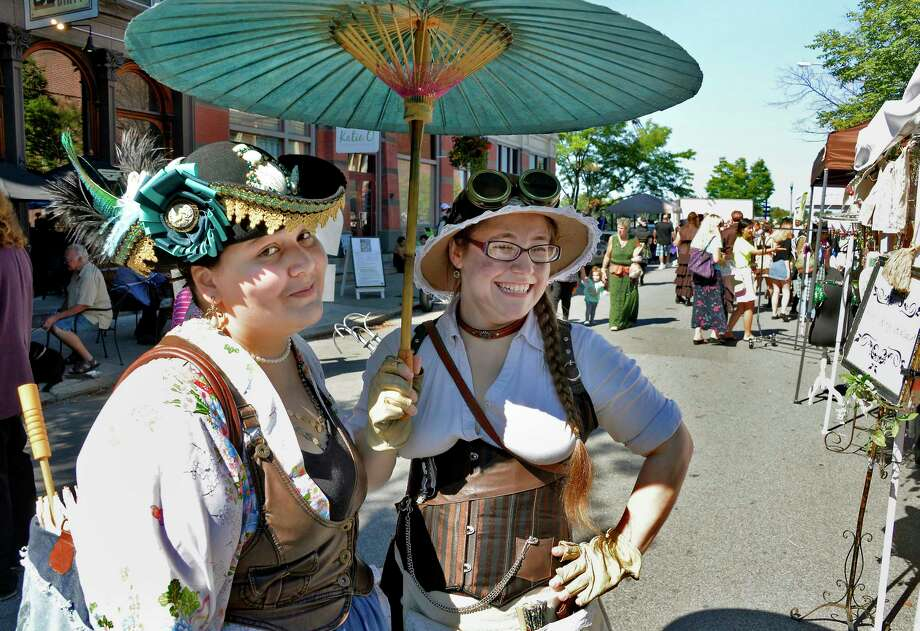 Kate Carter, left, and Amanda Charlebois, both of Cohoes, during The Enchanted City, an urban street fair and spectacle of steampunk fashion Saturday Sept. 15, 2018 in Troy, NY.  (John Carl D'Annibale/Times Union) Photo: John Carl D'Annibale / 20044820A