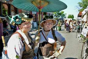 Kate Carter, left, and Amanda Charlebois, both of Cohoes, during The Enchanted City, an urban street fair and spectacle of steampunk fashion Saturday Sept. 15, 2018 in Troy, NY. (John Carl D'Annibale/Times Union)
