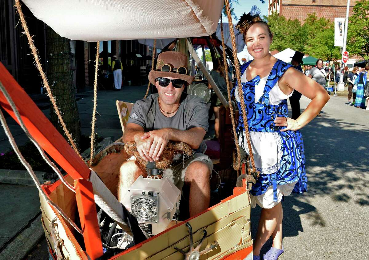 Neil Meyer and Jessica Sherwood, both of Wallkill, pose in a steampunk dirigible airship at The Enchanted City, an urban street fair and spectacle of steampunk fashion Saturday Sept. 15, 2018 in Troy, NY. (John Carl D'Annibale/Times Union)