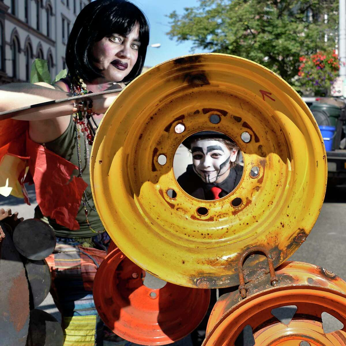 Heather Dalton and her daughter Allison, 7, pose in costume at a steampunk sculpture during The Enchanted City, an urban street fair and spectacle of steampunk fashion Saturday Sept. 15, 2018 in Troy, NY. (John Carl D'Annibale/Times Union)