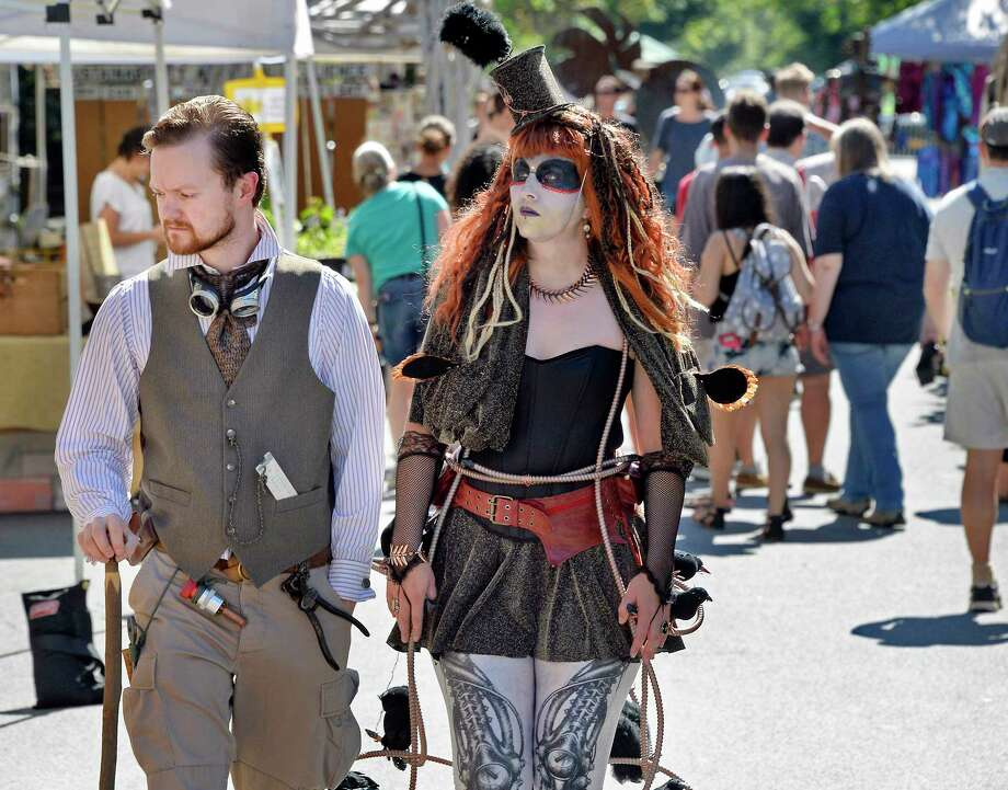 Asa Snyder and Cara Davis, both of Petersburg, take in the sights during The Enchanted City, an urban street fair and spectacle of steampunk fashion Saturday Sept. 15, 2018 in Troy, NY.  (John Carl D'Annibale/Times Union) Photo: John Carl D'Annibale / 20044820A