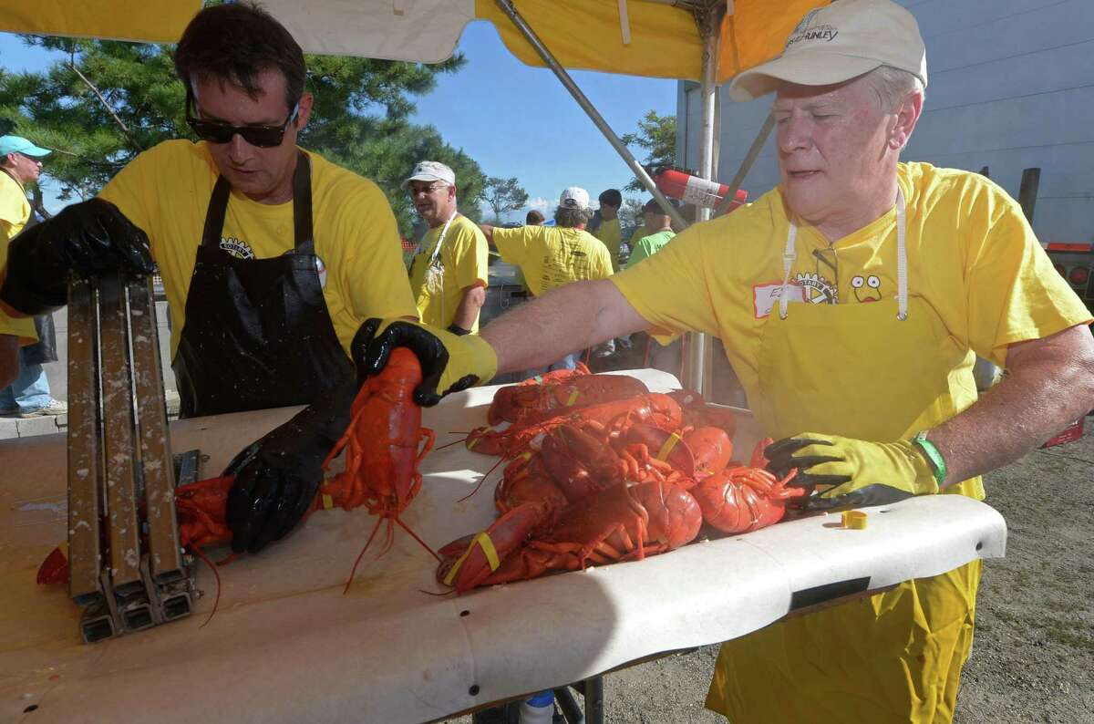 Westport Rotarians Jonathan Baron and Ed Hynes crack lobsters for the 7th annual Westport Rotary Club Lobster Fest Saturday, September 2018, Saturday, September 2018, at Compo Beach in Westport, Conn. About 2,400 lobsters were scheduled to be pulled from the water in Maine Friday to ensure the freshest dinners possible.