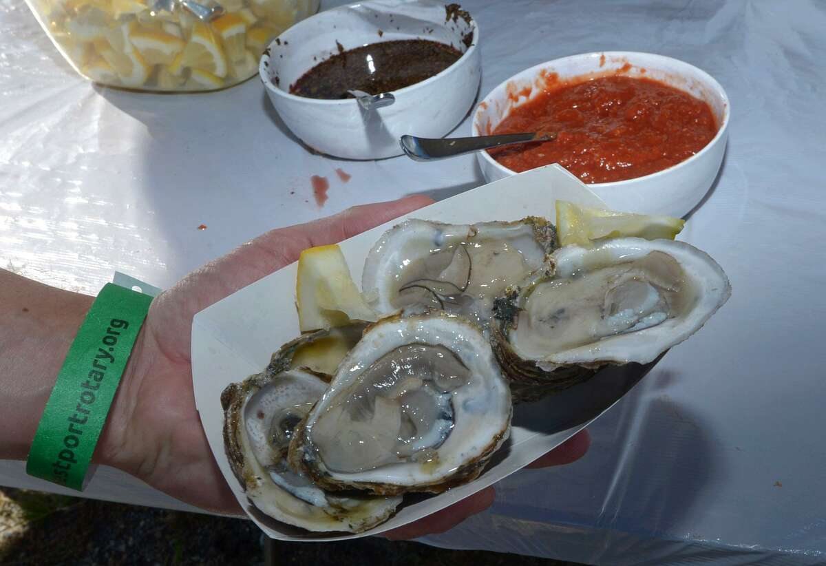 Attendees enjoy seafood including oysters from Copps Island Oysters during the 7th annual Westport Rotary Club Lobster Fest Saturday, September 2018, Saturday, September 2018, at Compo Beach in Westport, Conn. About 2,400 lobsters were scheduled to be pulled from the water in Maine Friday to ensure the freshest dinners possible.