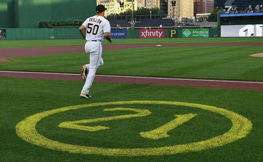 Jameson Taillon (50) of the Pittsburgh Pirates heads to the mound past a field decoration honoring Roberto Clemente on Roberto Clemente day against the Cincinnati Reds at PNC Park on September 5, 2018 in Pittsburgh, Pennsylvania. Photo: Justin Berl, Stringer / Getty Images / 2018 Getty Images