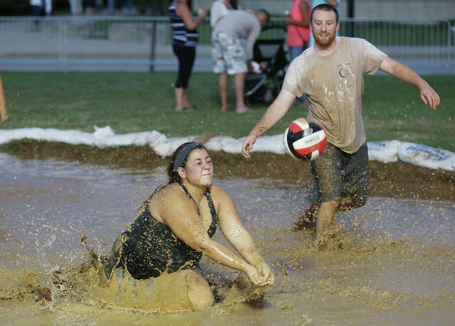 Scenes from Friday night's Mud Volleyball Tournament, sponsored by Bluff City Bar & Grill in Alton, at the annual Alton Expo in Riverfront Park. Fans and participants alike seemed to enjoy the messy matchups. Photo: John Badman | The Telegraph