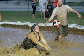 Scenes from Friday night's Mud Volleyball Tournament, sponsored by Bluff City Bar & Grill in Alton, at the annual Alton Expo in Riverfront Park. Fans and participants alike seemed to enjoy the messy matchups.