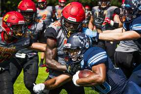 Northwood running back Jalen Lewis meets a blockade of Ferris State defenders, including Najeen Hosein, Will Hunt and Adrian Green during a game against Ferris State on Saturday, Sept. 15, 2018 at Northwood University in Midland. (Danielle McGrew Tenbusch/for the Daily News)