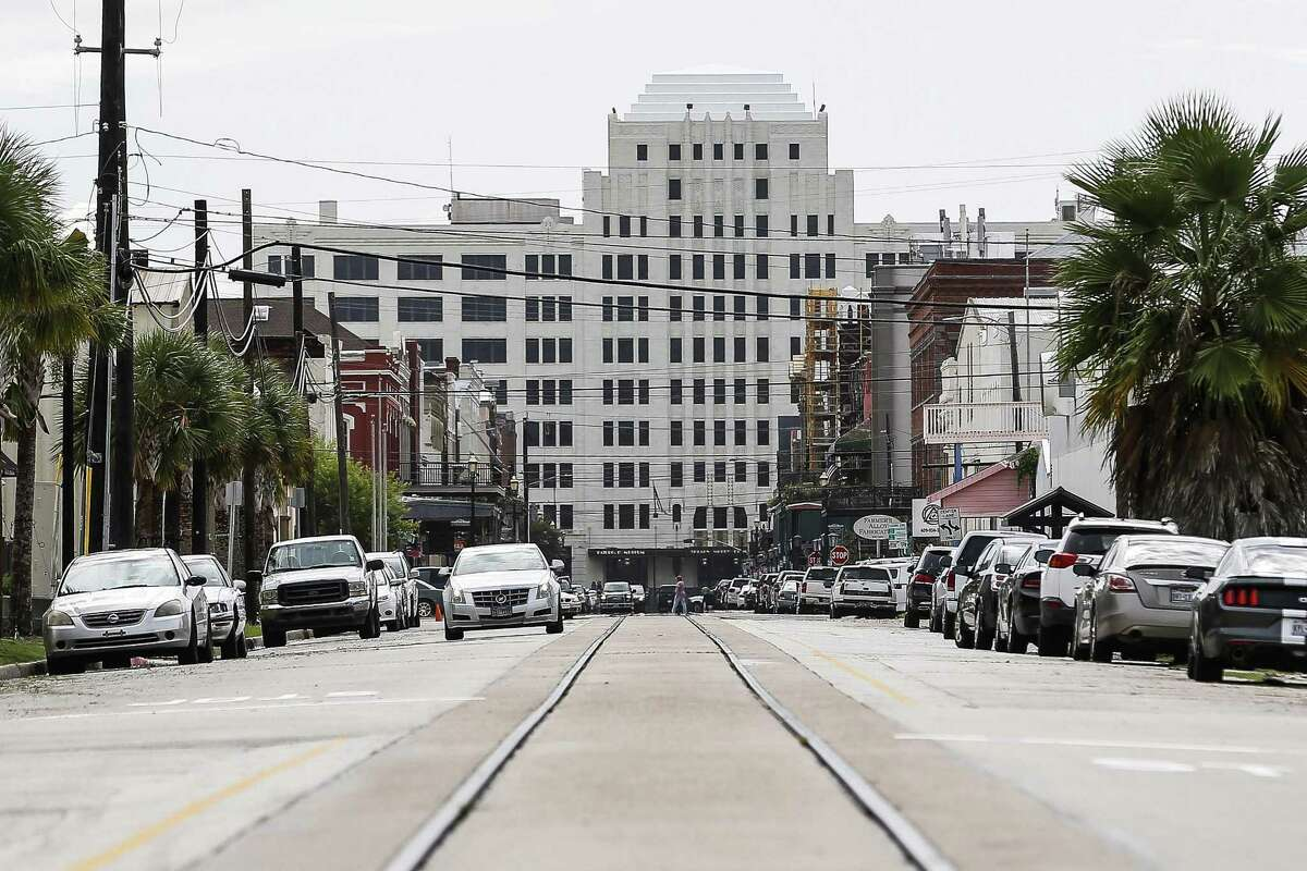FILE - Trolley tracks extend down Strand Street toward downtown in Galveston on Sept. 13, 2018.