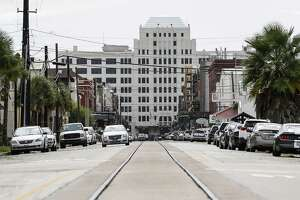 Trolley tracks extend down Strand Street toward downtown Thursday Sept. 13, 2018 in Galveston ten years after Hurricane Ike hit the Texas coast.