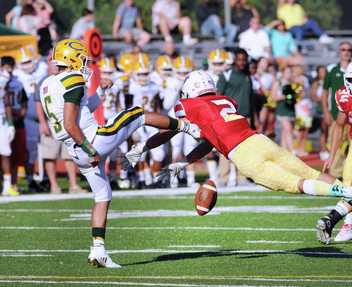 Greenwich's Evan Weigold blocks the punt of Trinity kicker Sam Pensiero during the second quarter on Saturday.