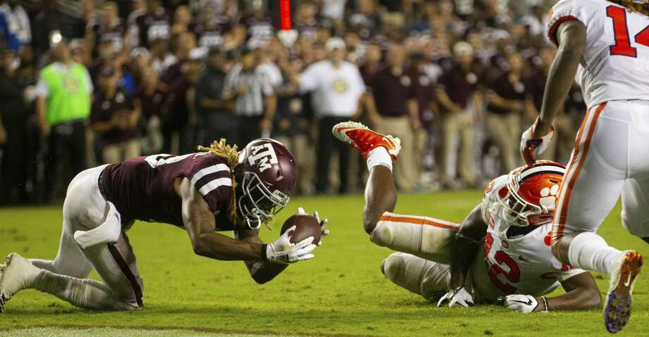 Texas A&M wide receiver Kendrick Rogers (13) catches a pass for a touchdown after it was bobbled by Clemson defensive back K'Von Wallace (12) during the fourth quarter of an NCAA college football game Saturday, Sept. 8, 2018, in College Station, Texas. (AP Photo/Sam Craft) Photo: Sam Craft/Associated Press