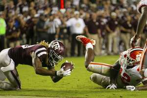 Texas A&M wide receiver Kendrick Rogers (13) catches a pass for a touchdown after it was bobbled by Clemson defensive back K'Von Wallace (12) during the fourth quarter of an NCAA college football game Saturday, Sept. 8, 2018, in College Station, Texas. (AP Photo/Sam Craft)