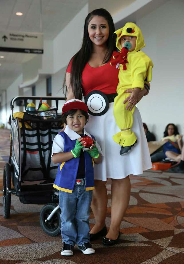 Maglyne Ponce and her sons Donovan, 3, and Anakin, 1, pose for a photo at the first-ever Fandemic Tour at NRG Center on Saturday, Sept. 15, 2018, in Houston. The Ponce family dressed up as Pokémon characters. Photo: Yi-Chin Lee, Staff Photographer / © 2018 Houston Chronicle