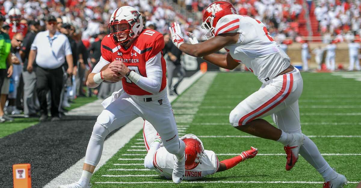 LUBBOCK, TX - SEPTEMBER 15: Alan Bowman #10 of the Texas Tech Red Raiders is pushed out of bounds just short of the goal line by Roman Brown #20 of the Houston Cougars during the first half of the game on September 15, 2018 at Jones AT&T Stadium in Lubbock, Texas. (Photo by John Weast/Getty Images)
