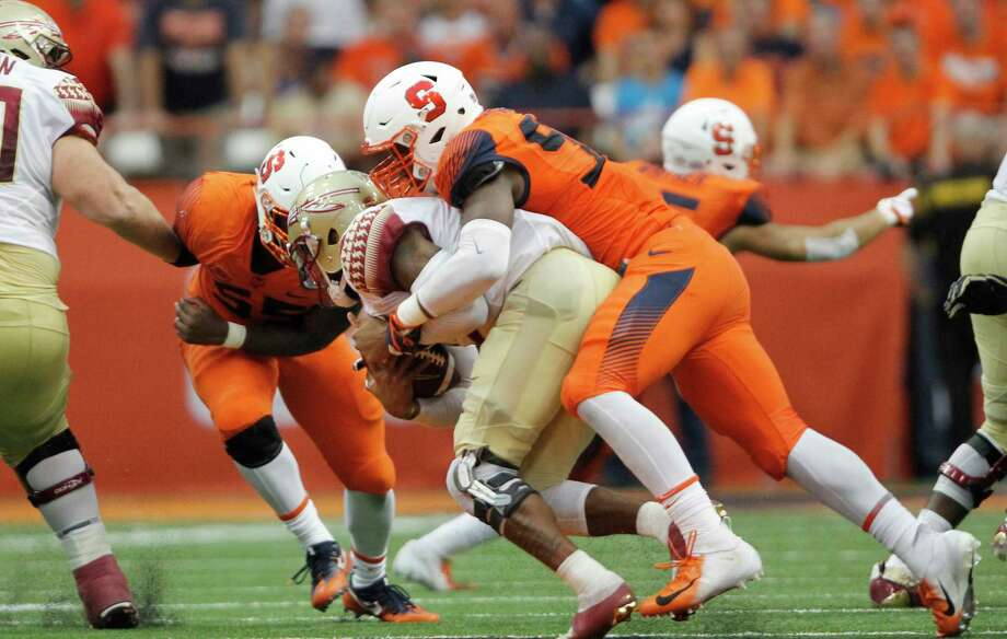 Syracuse's Jake Pickard, right, sacks Florida State's Deondre Francois, left, in the fourth quarter of an NCAA college football game in Syracuse, N.Y., Saturday, Sept. 15, 2018. Syracuse won 30-7. (AP Photo/Nick Lisi) Photo: Nick Lisi / FR171024 AP
