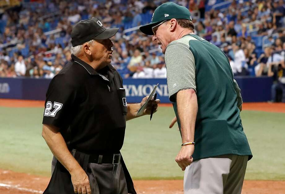 ST. PETERSBURG, FL - SEPTEMBER 15: Bob Melvin #6 of the Oakland Athletics, right, argues with some plate umpire Larry Vanover #27 after being ejected in the eighth inning of a baseball game at Tropicana Field on September 15, 2018 in St. Petersburg, Florida. (Photo by Mike Carlson/Getty Images) Photo: Mike Carlson / Getty Images