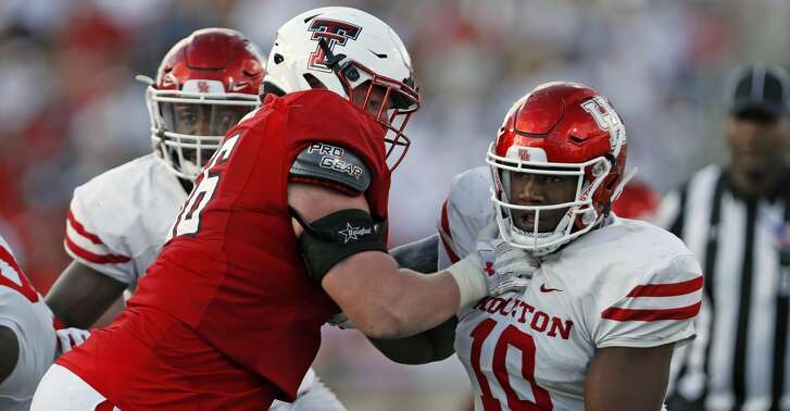 Houston's Ed Oliver (10) tries to break around Texas Tech's Paul Stawarz (76) during an NCAA college football game Saturday, Sept. 15, 2018, in Lubbock, Texas. (Brad Tollefson/Lubbock Avalanche-Journal via AP)