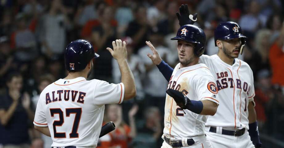 Houston Astros Alex Bregman (2) celebrates his run scored on a single by Yuli Gurriel during the sixth inning of an MLB game at Minute Maid Park, Saturday, September 15, 2018, in Houston. Photo: Karen Warren/Staff Photographer