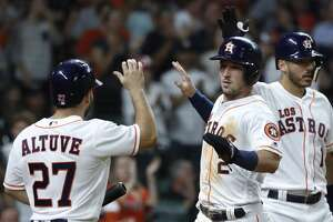 Houston Astros Alex Bregman (2) celebrates his run scored on a single by Yuli Gurriel during the sixth inning of an MLB game at Minute Maid Park, Saturday, September 15, 2018, in Houston.