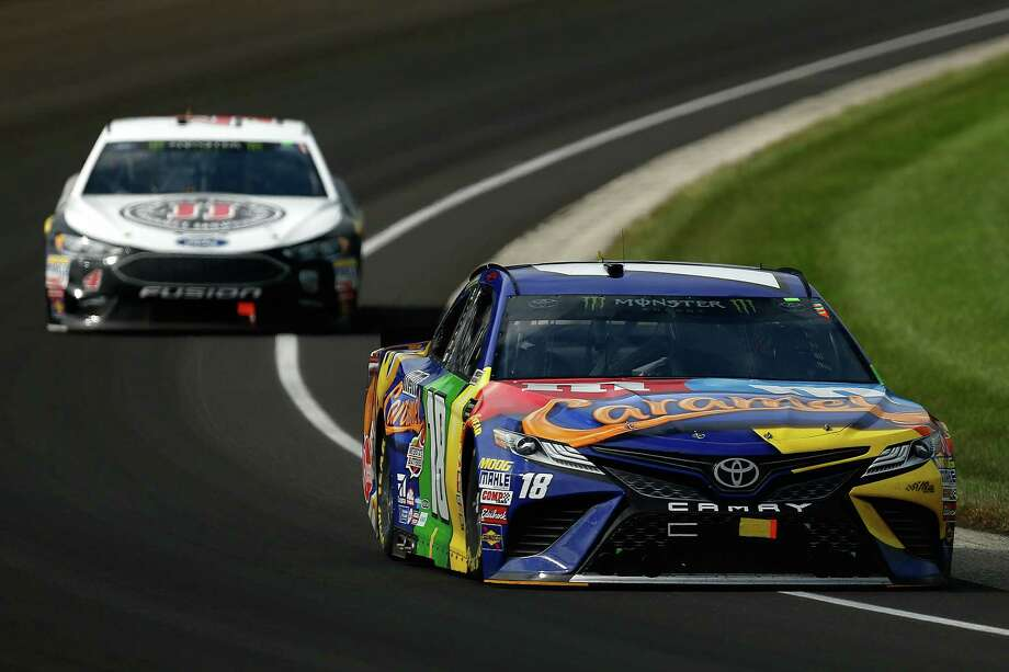 INDIANAPOLIS, IN - SEPTEMBER 10:  Kyle Busch, driver of the #18 M&M's Caramel Toyota, leads Kevin Harvick, driver of the #4 Jimmy John's New 9-Grain Wheat Sub Ford, during the Monster Energy NASCAR Cup Series Big Machine Vodka 400 at the Brickyard at Indianapolis Motor Speedway on September 10, 2018 in Indianapolis, Indiana.  (Photo by Michael Reaves/Getty Images) Photo: Michael Reaves / 2018 Getty Images