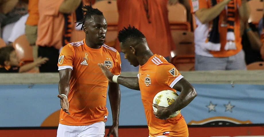 Houston Dynamo midfielder Romell Quioto (31) congratulates midfielder Alberth Elis (17) for Elis' goal at the 32nd minute of the first half of the MLS game at BBVA Compass Stadium on Saturday, Sept. 15, 2018, in Houston. Photo: Yi-Chin Lee/Staff Photographer / © 2018 Houston Chronicle