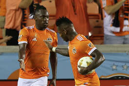 Houston Dynamo midfielder Romell Quioto (31) congratulates midfielder Alberth Elis (17) for Elis' goal at the 32nd minute of the first half of the MLS game at BBVA Compass Stadium on Saturday, Sept. 15, 2018, in Houston.