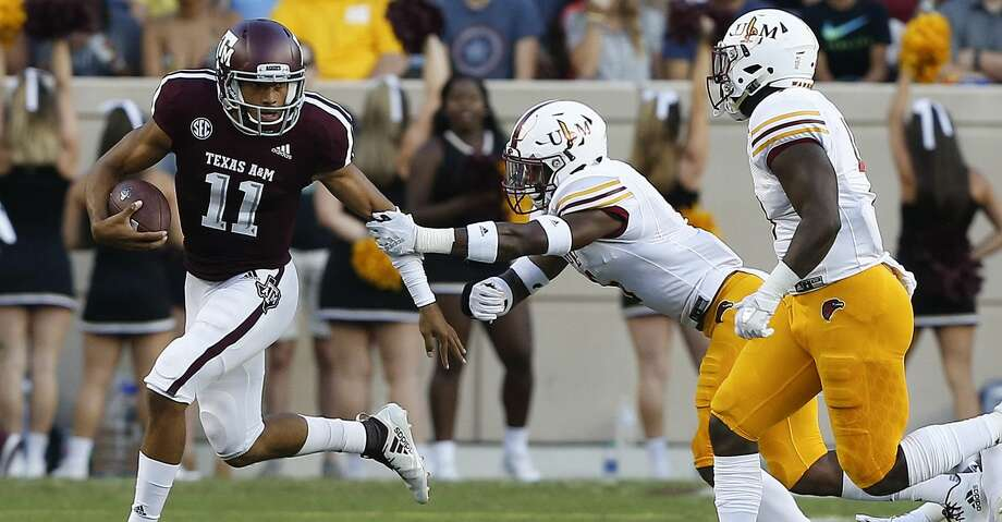 COLLEGE STATION, TX - SEPTEMBER 15:  Kellen Mond #11 of the Texas A&M Aggies avoids the tackle of Wesley Thompson #6 of the Louisiana Monroe Warhawks in the first quarter at Kyle Field on September 15, 2018 in College Station, Texas.  (Photo by Bob Levey/Getty Images) Photo: Bob Levey/Getty Images