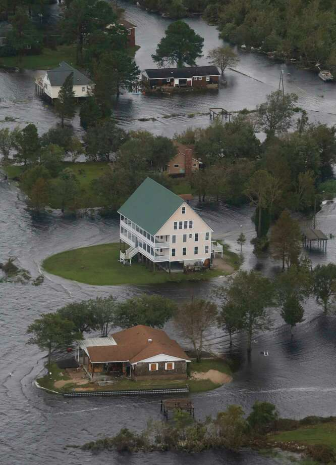 Houses are surrounded by water from Florence, now a tropical storm,  in New Bern, NC., Saturday, Sept. 15, 2018. (AP Photo/Steve Helber) Photo: Steve Helber / Copyright 2018 The Associated Press. All rights reserved