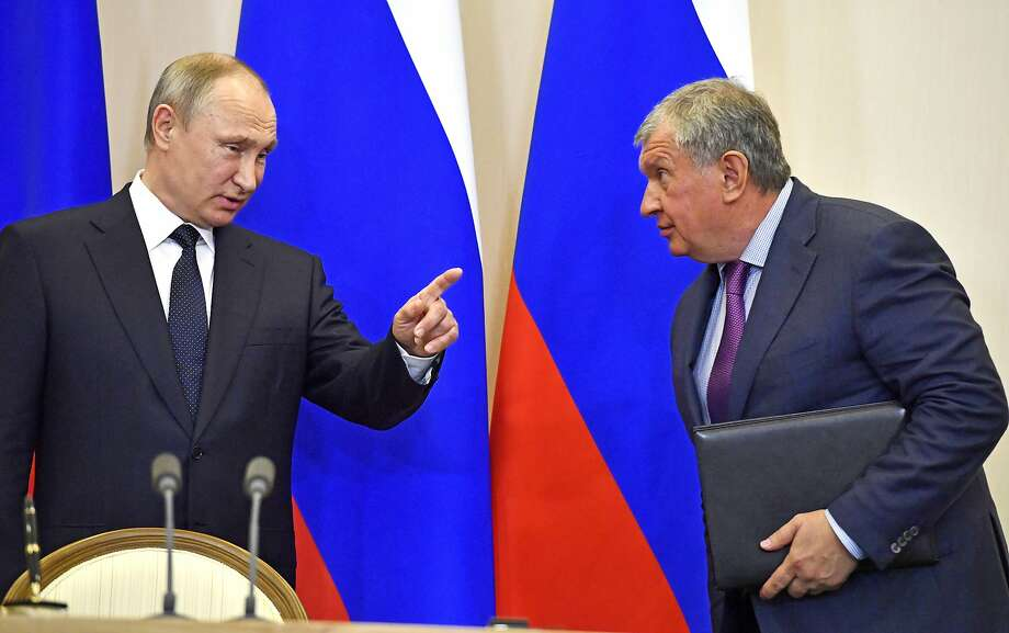 FILE In this file photo taken on Wednesday, May 12, 2018, Russian President Vladimir Putin, left, speaks with Igor Sechin, CEO of Russian oil giant Rosneft, at a joint news conference. Photo: Yuri Kadobnov, Associated Press